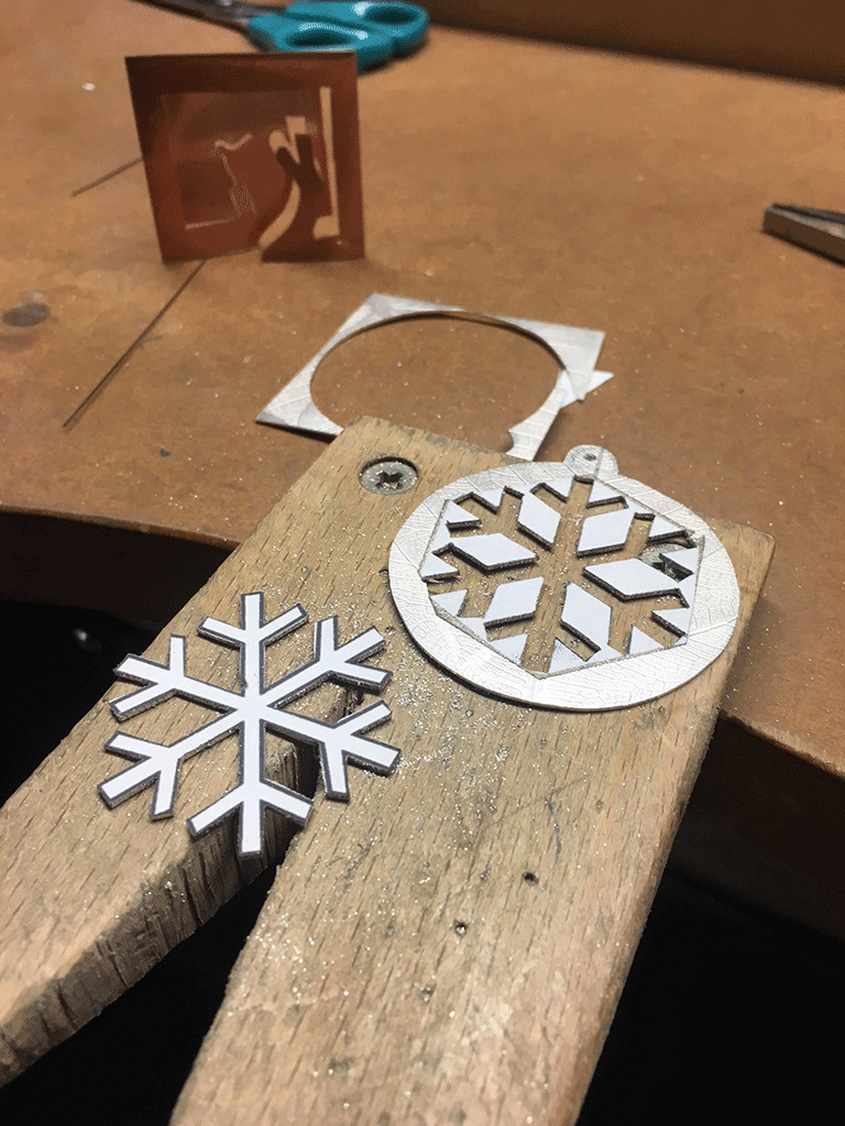 Both decorations cut out of single 5cm square sheet ready for finishing