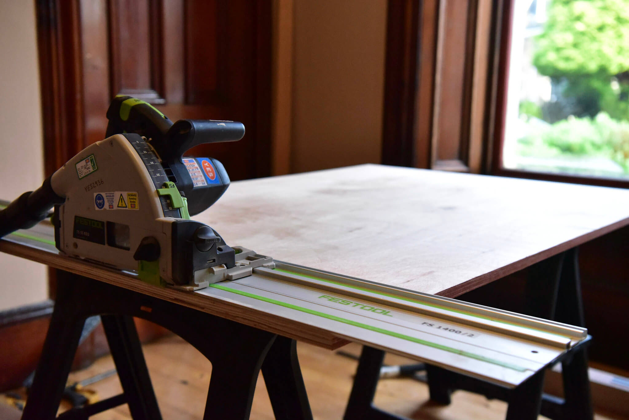 A plunge saw was used to create straight square cuts of the plywood.