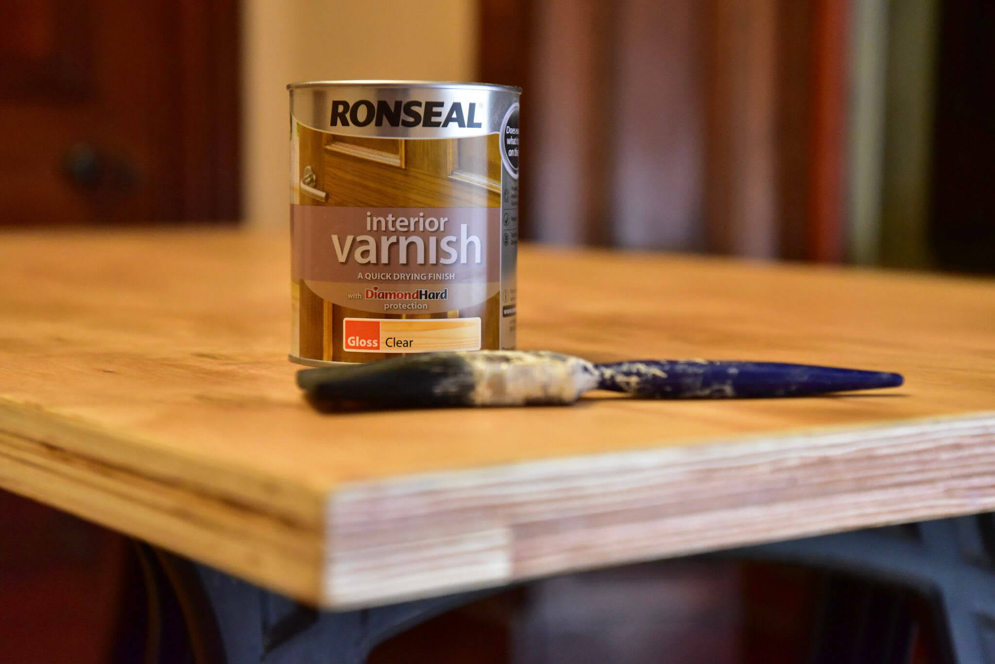 Several coats of varnish which applied to the desk top. Wire wool was used to burnish varnish between each coat.
