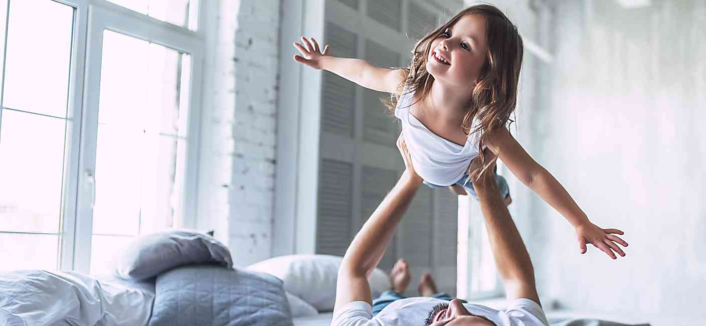 Dad and daughter playing airplane