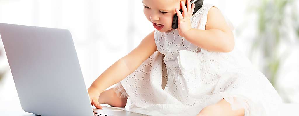 Baby girl calling and a laptop