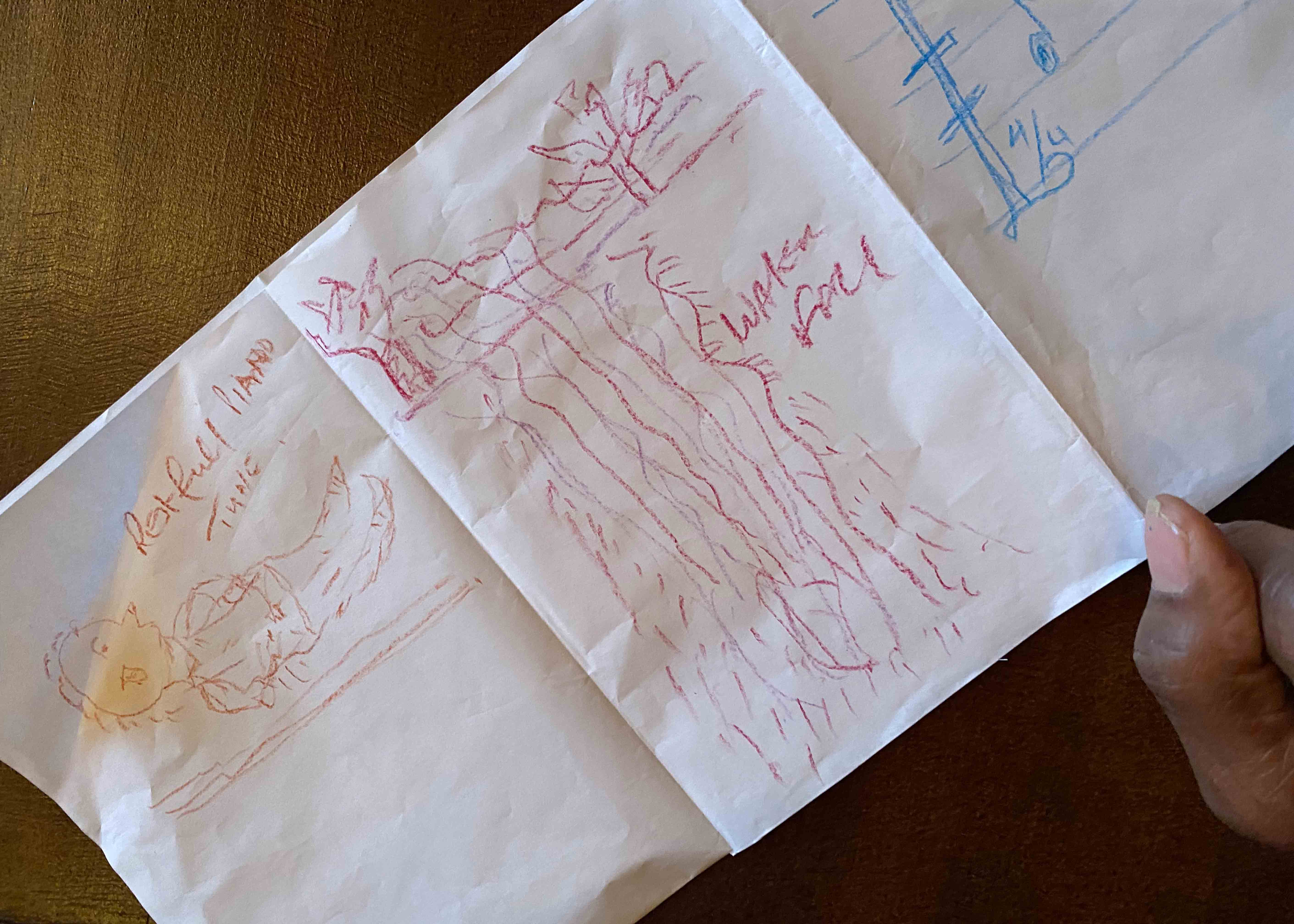 Detail of drawings on a folded piece of paper