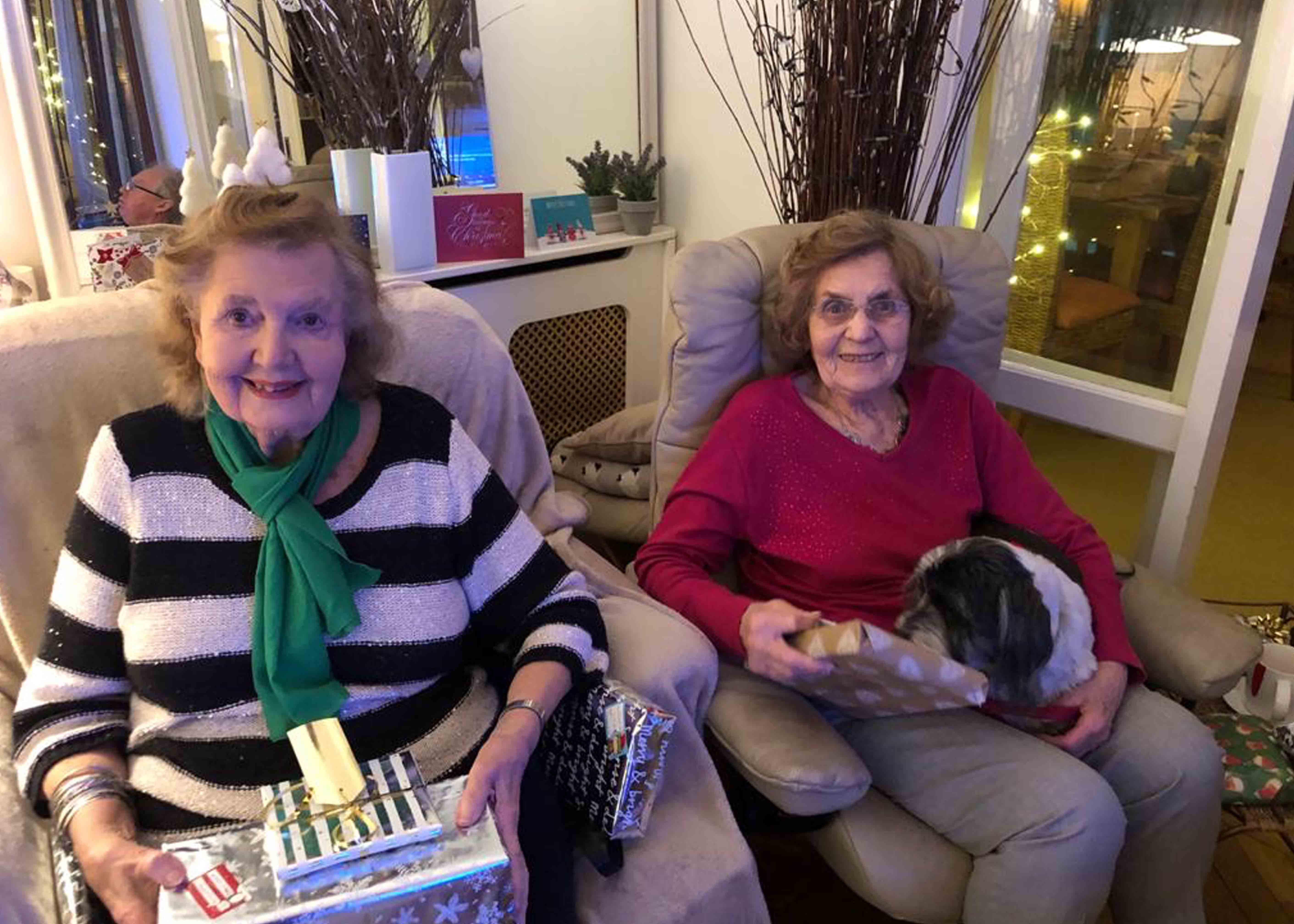 Two elderly women with presents