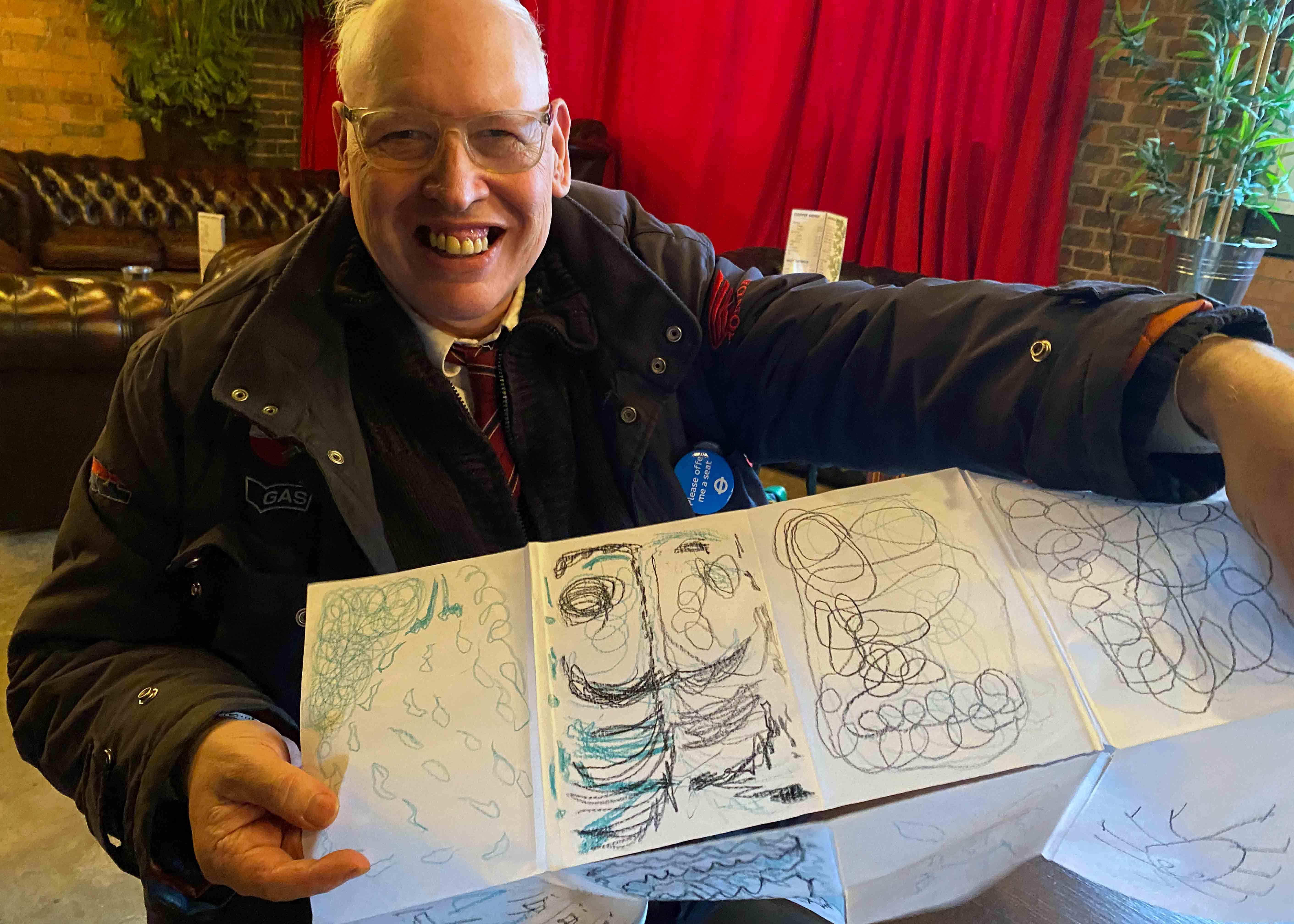 Man holding drawing