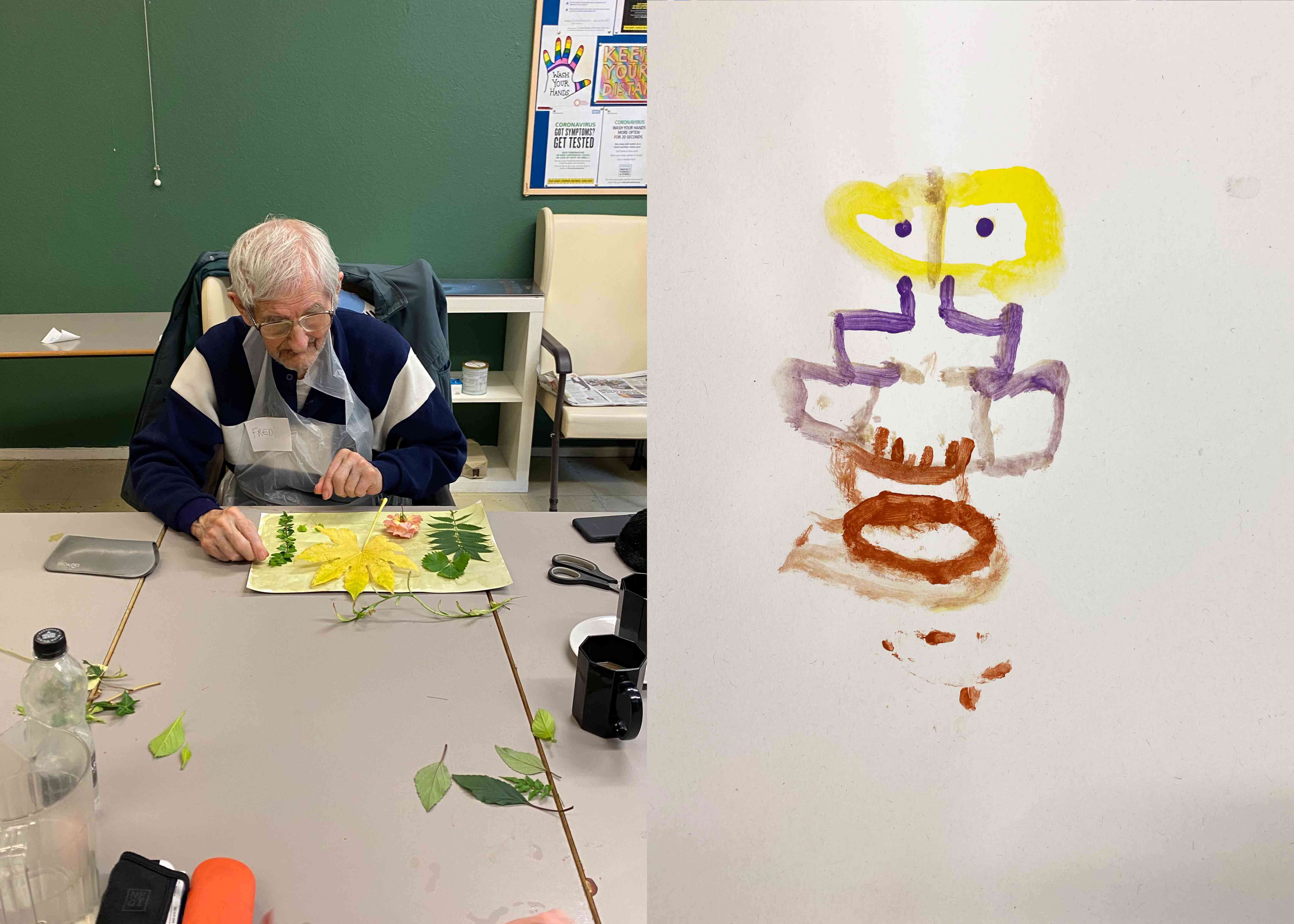 Man creating art with leaves and a drawing of a face