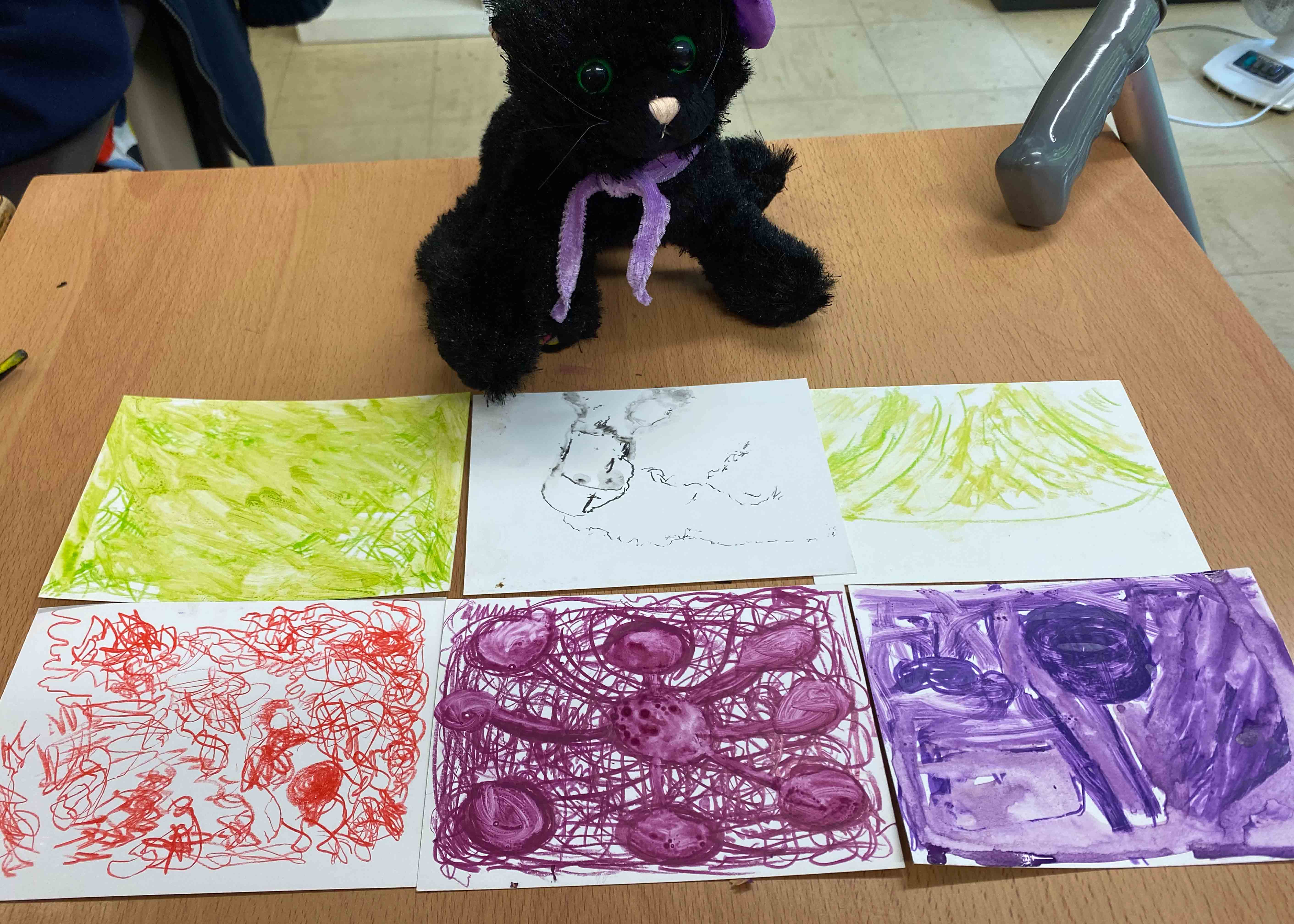 Expressive drawings and a toy cat