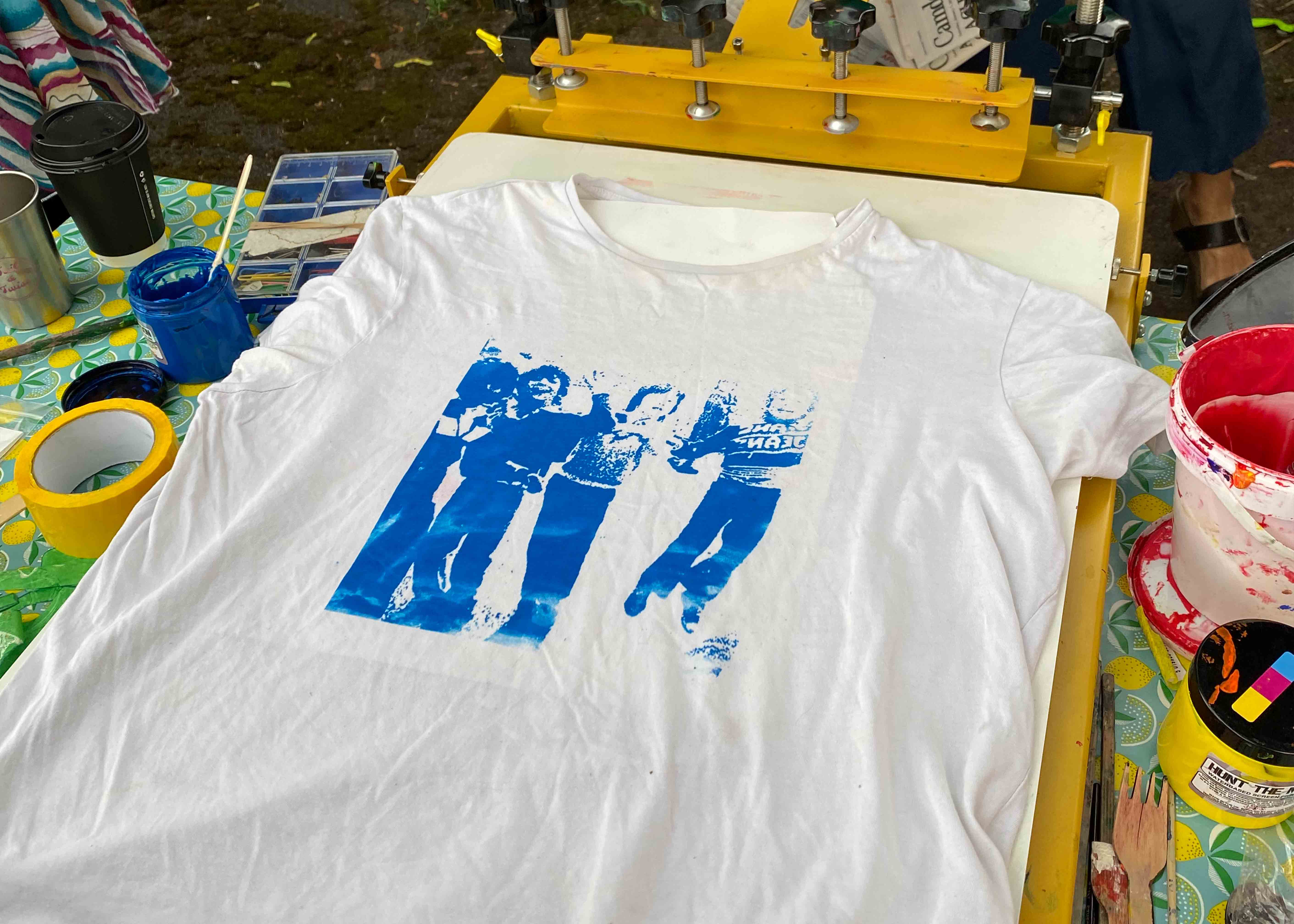 A t-shirt being screen printed
