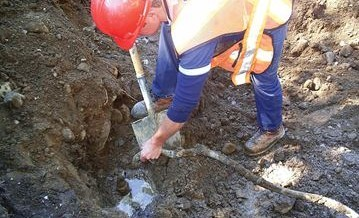 A crew member replaces a lead and galvanized steel service line. (Image courtesy of the City of Flint.)