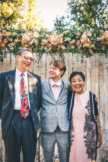 The author with his godparents, Tien (left) and Dadi (right). (Image courtesy of Le Voyager Photography.)