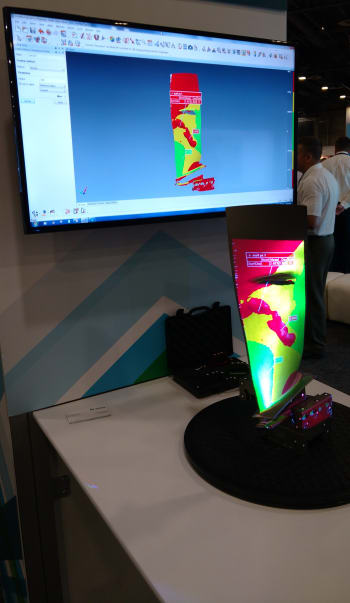 The stereoScan projecting measurement results onto a part in the Manufacturing Intelligence booth. (Image courtesy of the author.)