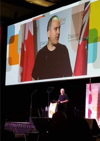 John Ruffolo giving his keynote at Discovery 2019.