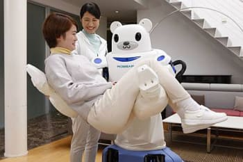 Robear lifting a patient for transfer from a bed to a wheelchair. (Image courtesy of Riken.)