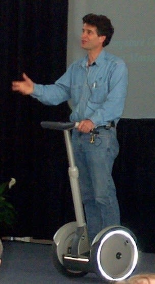 Dean Kamen showing off his most popular invention, the Segway. (Image courtesy of Jared C. Benedict.)
