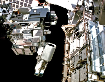 Robotic Refueling Mission 3's Multi-Function Tool 2, operated by Dextre, demonstrates robotic refueling operations on the outside of a space station. (Image courtesy of NASA.)