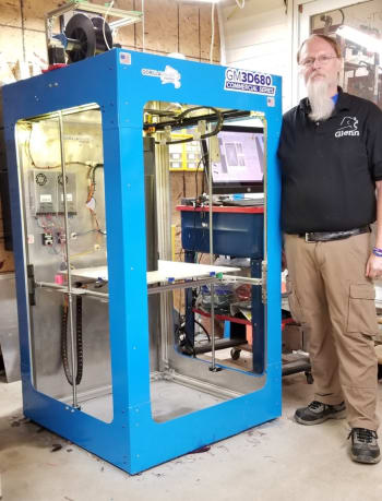 Figure 1. Glenn Warner with one of GorillaMaker's larger 3D printers, the GM3D680. (Image courtesy of GorlliaMaker.)