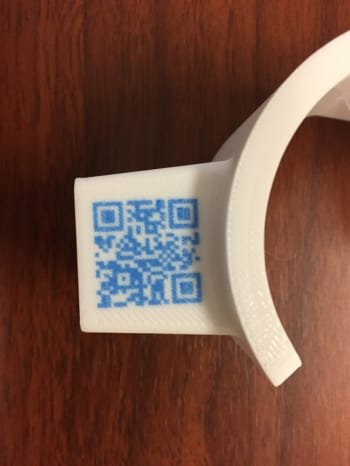 FA part 3D printed with APD featuring an embedded QR code. (Image courtesy of Rize.)