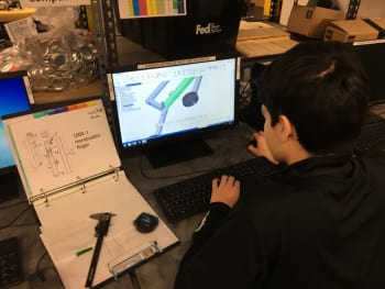 One of Burnham's students using Solid Edge to create Bowser's unique end effector/manipulator. It would be a critical component of the robot's design. (Image courtesy of Grant Butsumyo.)