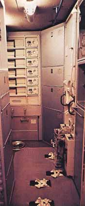 The waste management compartment with the fecal-urine collector mounted on the wall. (Image courtesy of NASA.)