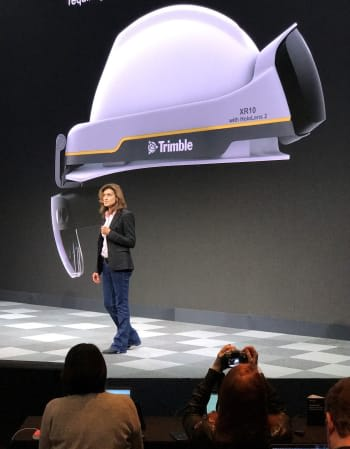 Hard hat goes high tech. Trimble's Roz Buick shows the Trimble XR10 with HoloLens 2 which includes a hardhat.  (Picture courtesy of Microsoft)