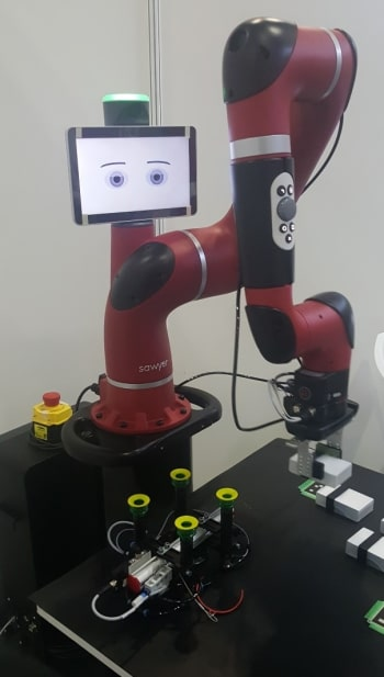 Modern day worker, mean stride...the SAWYER robot wants to take your job too.  (Image credit: P. Keane)