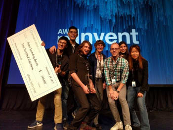 The UW Sounding Board team (left to right: Hao Fang, Hao Cheng, Ari Holtzman, Mari Ostendorf, Maarten Sap, Elizabeth Clark, Yejin Choi) wins Amazon's inaugural Alexa Prize. (Image courtesy of University of Washington.)