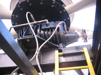 Two accelerometer transducers are mounted on a gear drive near the low speed output/fan shaft (left) and the high-speed input shaft. This arrangement could be utilized as part of a vibration management program.