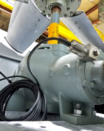 The upgraded solid-state, electronic vibration switch can be mounted directly on a gear drive to more accurately measure the amount of vibration in a cooling tower.