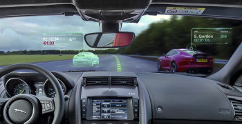 Technolgy in the forefront. The Jaguar Virtual Windscreen is intended to  befriend drivers on the race track  find the most out of their car. It offers the driver an augmented reality view of the world by projecting images onto the windshield that can provide  particular at-a-glance information about the world around them.