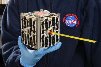 The team hopes to use asymmetrical mirrors to produce telescopes and optical equipment small enough to ride a CubeSat like this one. (Image courtesy of NASA.)
