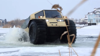 The SHERP ATV's unique tires keep it afloat and let it climb out of icy waters. (Image courtesy of SHERP/YouTube.)