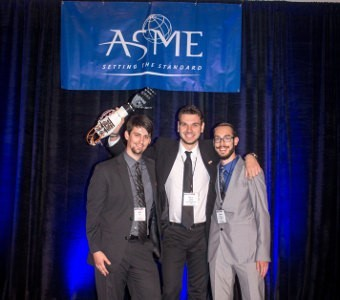 Tennessee Tech students Scott Hill, Chas Davies and Nikola Tepavac, hold their winning robotic arm on high.