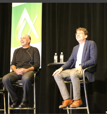 Autodesk's Carl Bass, CEO, and Jeff Kowalski, CTO, happy to be in technology's driver's seats at Autodesk University 2016. (Image courtesy of Autodesk.)
