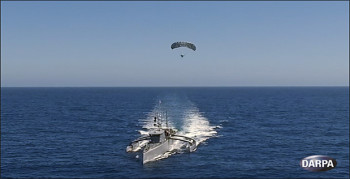 The TALONS system deployed and tethered to an ACTUV vessel. (Image courtesy of DARPA.)