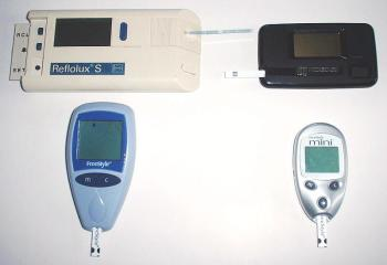 Examples of glucometers for diabetes management, from the late 1980s to early 2000s. Top left: Reflolux S (Accu-Chek III in the U.S.), by Boehringer Mannheim, introduced 1991. Top right: ExacTech Card, by MediSense. Introduced 1987. Bottom left: FreeStyle, by TheraSense. Introduced 2003. Bottom right: Freestyle Mini, by Abbott. Introduced 2004