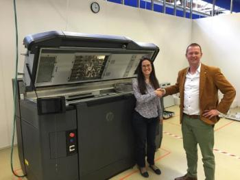 HP claims its Jet Fusion 3D Printer is 10 times faster than the rest. HP's Virginia Palacio and Shapeways' Vice President of Manufacturing Stefan Rink photographed with the printer. (Image courtesy of Shapeways.)