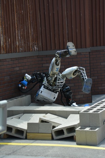 I've fallen and I can't get up: After a tumble like this, most humanoid robots are unable to right themselves. (Image courtesy of DARPA.)