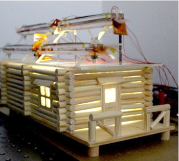LEDs are powered inside a model home that has a hybrid solar and wind energy generator on the roof. (Image courtesy of the American Chemical Society.)