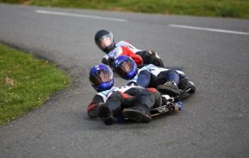 Professional street lugers race down a track.