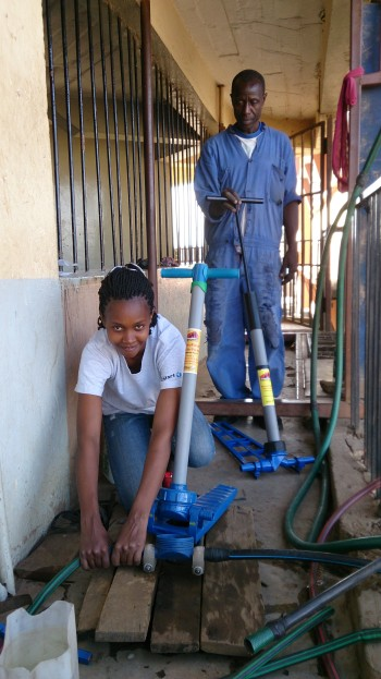 Winfred Maingi prepares to test a Starter Pump while Dalmas Otieno stands by with a larger MoneyMaker Hip Pump. Both are from KickStart International. (Image courtesy of KickStart International.)