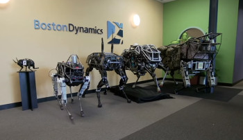 Spot (second to left) and its siblings LittleDog, BigDog, WildCat and LS3 (left to right) are part of a military-funded program which keeps details under wraps. (Image courtesy of Boston Dynamics.)