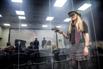 The HMD suite is separated from the auditorium by an electrostatic glass wall. Spectators in the auditorium have access to stereo glasses for review or participation. (Image courtesy of Virtalis.)