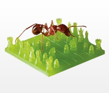 Thermoplastic-like chess board made with stereolithography—ant for scale. (Image courtesy of Proto Labs.)