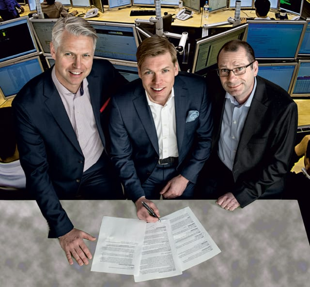 """Signing the Deal. Dassault's Nordic sales director, Mårten Gustafsson (in the middle), characterized the Ericsson deal as, """"Winning an Olympic gold medal"""". Both in terms of the prestige it brought to DS to have the Ericsson logo on the 3DEXPERIENCE customer list, but even more so related to the revenues it would generate. To the left, Ericsson's Johan Torstensson, CIO, and to the right, Joakim Cerwall, who, back in 2016, held the position VP of Group Function Technology. (Image courtesy of Bosse Johansson.)"""
