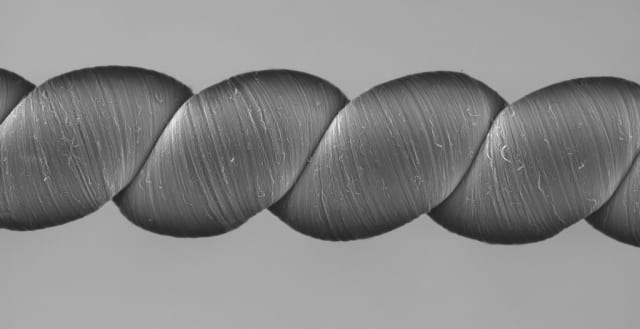 Coiled carbon nanotube yarns, created at the University of Texas at Dallas and imaged here with a scanning electron microscope, generate electrical energy when stretched or twisted. (Image courtesy of the University of Texas at Dallas.)