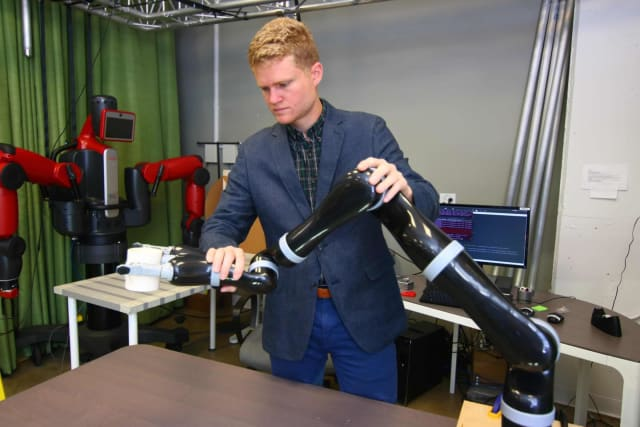 Rice University researchers led by graduate student Dylan Losey want to help humans and robots collaborate by enabling interactive tasks like rehabilitation, surgery and training programs in which environments are less predictable. In early studies, Losey and colleagues at the University of California, Berkeley, used gentle feedback to train a robot arm to manipulate a coffee cup in real time. (Image courtesy Andrea Bajcsy)