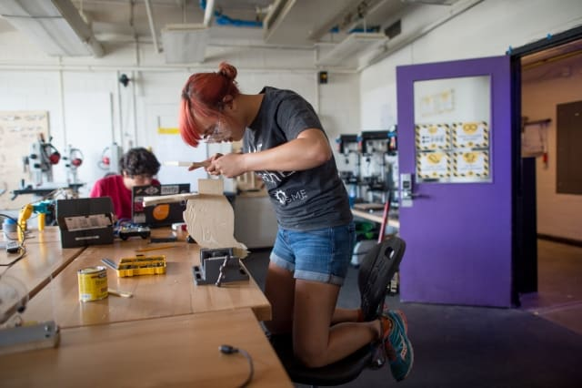 Student involved in a maker project. (Image courtesy of MIT.)