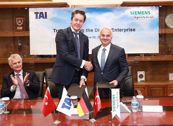 SHAKING HANDS ON THE BIG PLM DEAL. Representatives of the Siemens PLM and Turkish Aerospace Industries (TAI), shake hands at a signing ceremony in Ankara after the negotiations that landed the year's largest PLM contract. To the right, TAI's CEO, Temel Kotil, to the left the representative for Siemens PLM.  The agreement, worth about $15 million according to my calculations, is generally centers on developing a concept around digital twins. The Turkish aircraft developer and manufacturer has ambitions to grow vigorously from today's (2017) sales of nearly $2 billion to 5 billion in 2023, and advanced technology is the path to get there.