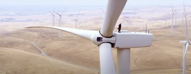 A technician services a wind turbine. (Image courtesy of NextEra Energy.)