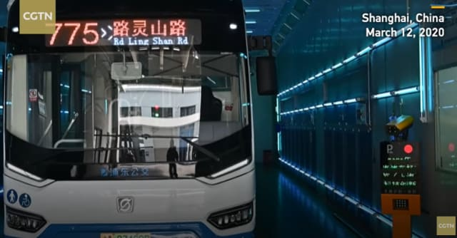 A bus undergoes UV-C treatment in Shanghai, China. Using 210 tubes emitting UV-C radiation, both inside and outside the bus,  Yanggao claims to have brought a 40-minute sterilization process down to five minutes, allowing the disinfection of 250 buses a day. (Image courtesy of YouTube.)