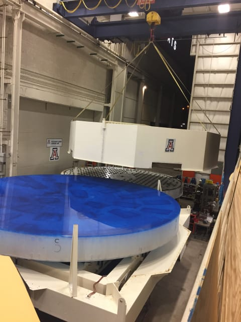 GMT mirror 1's transporter container lid is lifted into place at the Richard F. Caris Mirror Lab at the University of Arizona in September 2017. (Image courtesy of Giant Magellan Telescope - GMTO Corporation.)